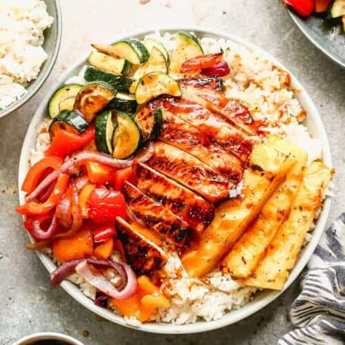 Hawaiian Bowls with coconut rice, grilled vegetables, teriyaki chicken and pineapple spears.