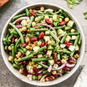 A serving bowl filled with Three Bean Salad made with fresh green beans.