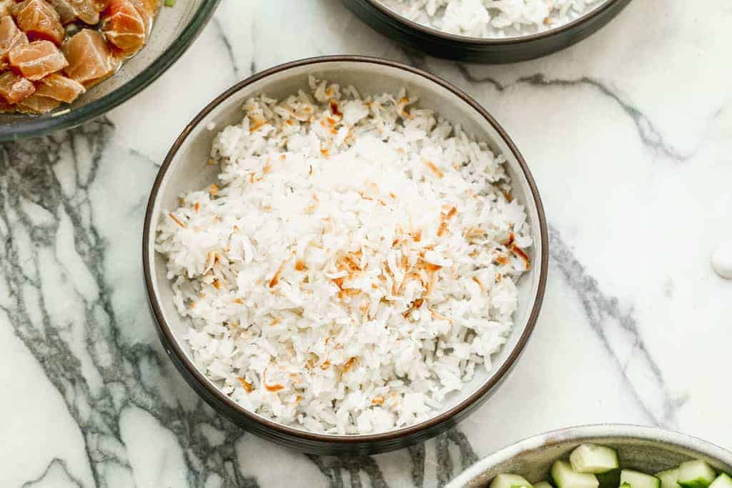 Cooked coconut rice in a serving bowl.