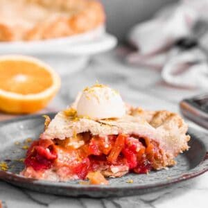 A slice of rhubarb pie on a plate.