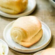 A homemade roll on a plate.