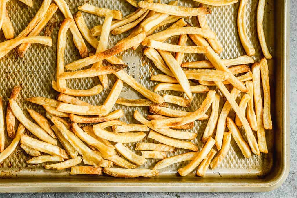 A pan with crispy cooked french fries.